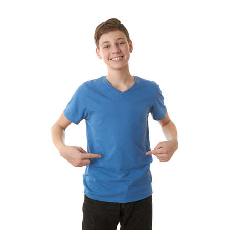 finger teen: Cute teenager boy in blue T-shirt pointing himself over white isolated background, half body