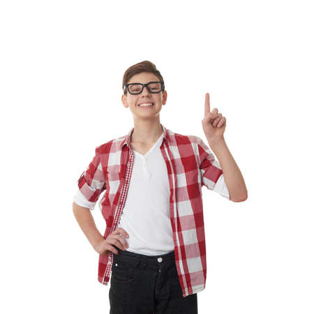 poor eyesight: Cute teenager boy in red checkered shirt and glasses pointing up over white isolated background, half body