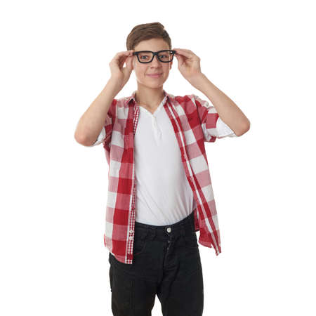 half body: Cute teenager boy in red checkered shirt and glasses over white isolated background, half body