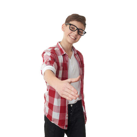 poor eyesight: Cute teenager boy in red checkered shirt and glasses stretching hand for greeting over white isolated background, half body