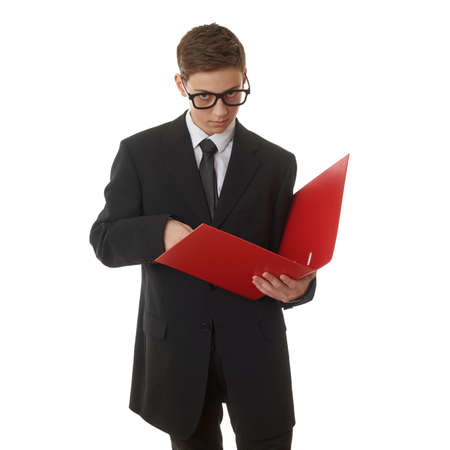 poor eyesight: Cute teenager boy in back business suit with a red folder over white isolated background, half body, future career concept Stock Photo