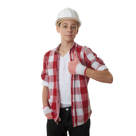 posing  agree: Cute teenager boy in red checkered shirt and building helmet showing thumb up sign over white isolated background, half body, constructing concept Stock Photo