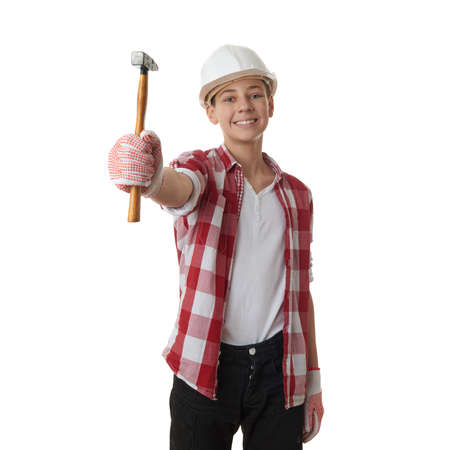 constructing: Cute teenager boy in red checkered shirt, building helmet and hammer over white isolated background, half body, constructing concept