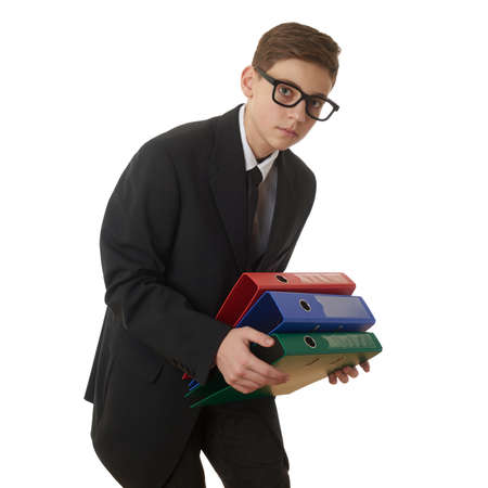 poor eyesight: Cute teenager boy in back business suit with a pile of folders over white isolated background, half body, future career concept