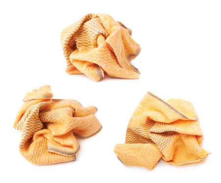 Crumpled yellow towel rag isolated over the white background Stock Photo