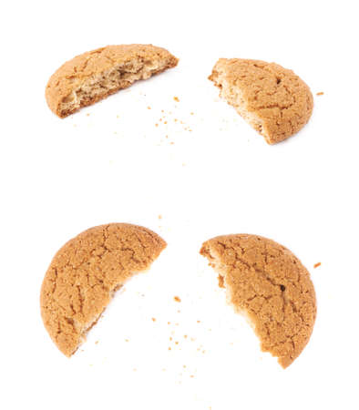 afters: Broken into pieces round cookie isolated over the white background