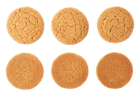 afters: Set of round cookies with the pieces of chocolate isolated over the white background