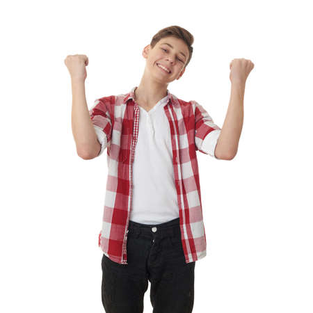 half body: Cute teenager boy in red checkered shirt with success gesture over white isolated background, half body