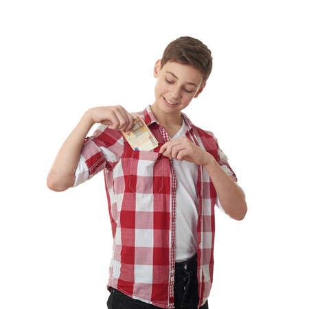 putting money in pocket: Cute teenager boy in red checkered shirt putting money into pocket over white isolated background, half body