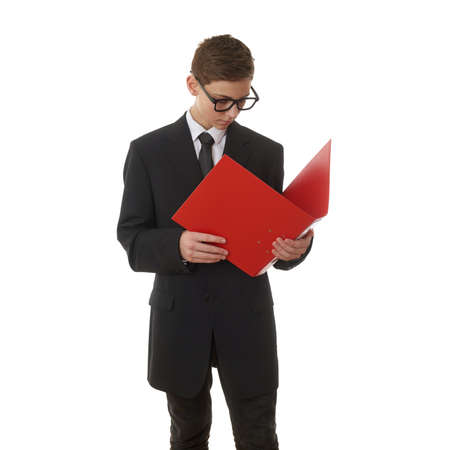 poor eyesight: Cute teenager boy in back business suit with red folder over white isolated background, half body, future career concept
