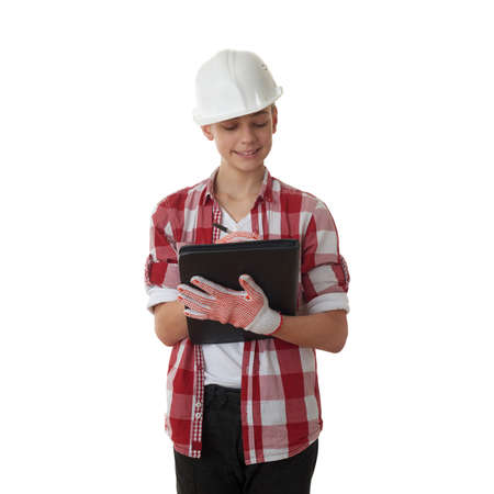 constructing: Cute teenager boy in red checkered shirt, building helmet and folder over white isolated background, half body, constructing concept Stock Photo