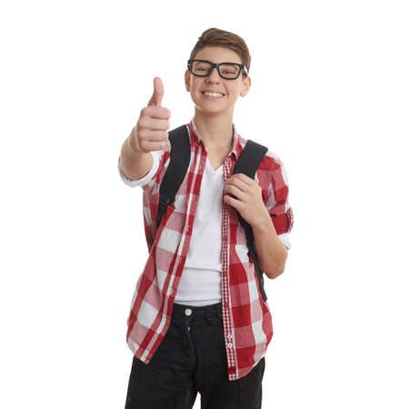 Cute teenager boy in red checkered shirt and glasses with school bag, gesturing thumb up over white isolated background, half body, as school, education concept