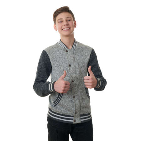 half body: Cute teenager boy in gray sweater showing thumb up sing over white isolated background, half body