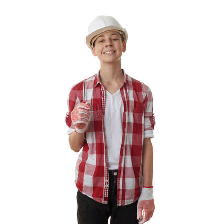 constructing: Cute teenager boy in red checkered shirt, building helmet and screwdriver over white isolated background, half body, constructing concept
