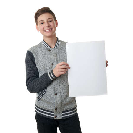 half body: Cute teenager boy in gray sweater holding paper bill board over white isolated background, half body Stock Photo