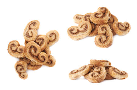 afters: Pile of twisted cookies with cinnamon isolated over the white background