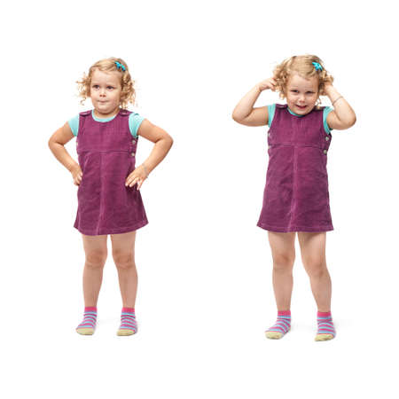 Young little girl with curly hair and arms on hips in purple dress standing over isolated white background