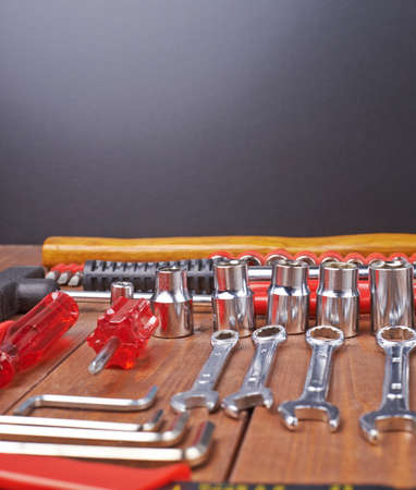 Set of different work tools on wooden brown surface Stock Photo
