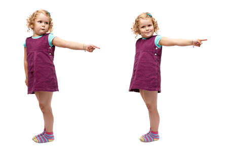 Young little girl with curly hair in purple dress standing and pointing to side copy space over isolated white background