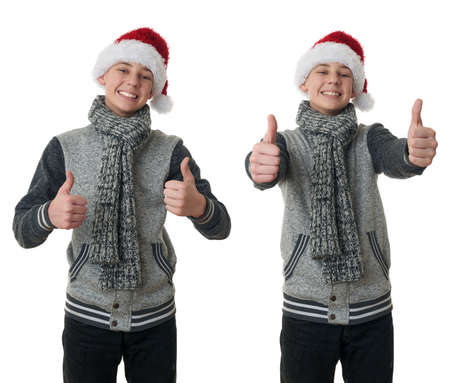 posing  agree: Set of cute teenager boy in gray sweater and christmas hat showing thumb up sign over white isolated background, half body