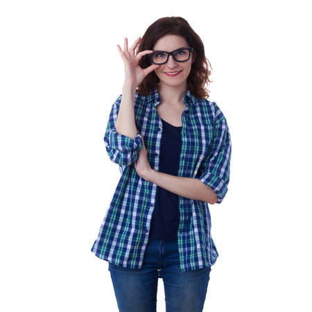 correcting: Smiling young woman in casual clothes and glasses over white isolated background correcting touching her glasses, happy people concept Stock Photo