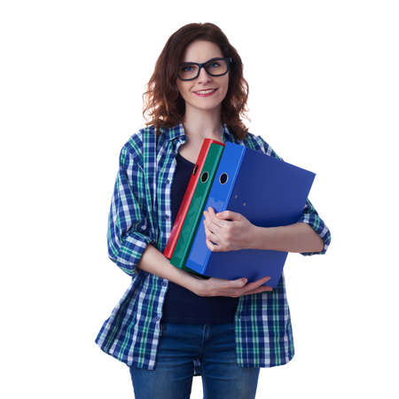 poor eyesight: Smiling young woman in casual clothes and glasses over white isolated background with a heap of folders, happy people and lot of work concept Stock Photo
