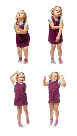 standing up: Young little girl with curly hair and crossed arms in purple dress jumping over isolated white background