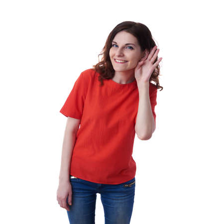 bruit: Smiling young woman in casual clothes over white isolated background listening to something, happy people concept