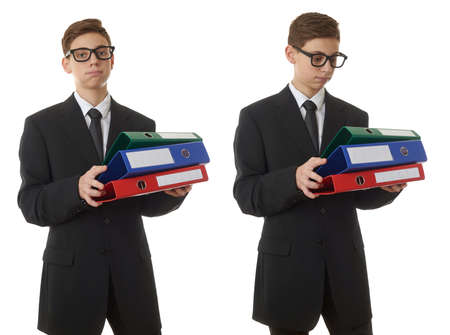 poor eyesight: Set of cute teenager boy in back business suit with a pile of folders over white isolated background, half body, future career concept