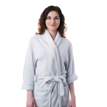 bath robe: Smiling young woman in bath robe over white isolated background morning, healthy, relaxation and beauty concept