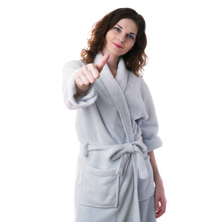 bath robe: Smiling young woman in bath robe over white isolated background showing thump up sign, morning, healthy, relaxation and beauty concept