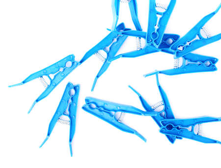 Pile of blue plastic cloth pegs isolated over white background