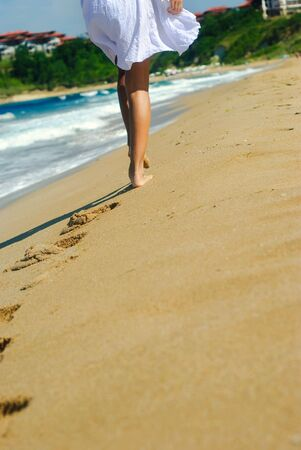 footmark: Girl is walking at the beach