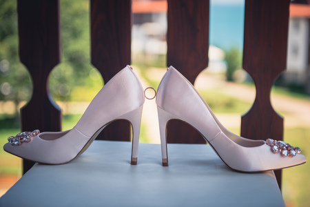 White shoes and ring of the Bride . wedding theme background