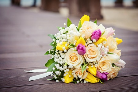 desirable: Yellow and pink wedding bouquet from roses