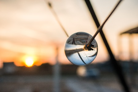 circumference: Street reflected inside the crystal ball. Sunset in Bulgaria