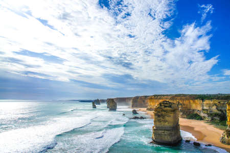 Twelve Apostles on Great Ocean Road with cloudy sky and wavy sea in Victoria, Australia Stock Photo