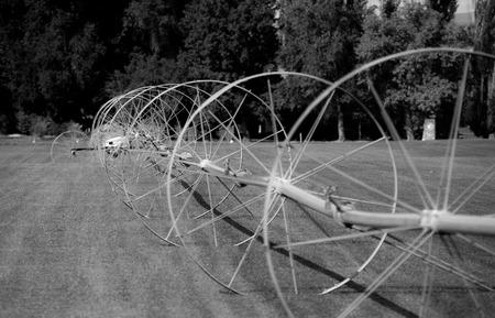 Zwart-witte irrigatiewielen voor golfbanen