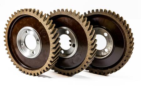 Antique automotive fiber camshaft timing gears on edge Stock Photo