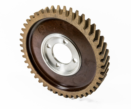 Antique automotive fiber camshaft timing gear on edge