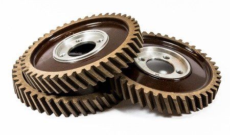 Antique automotive fiber camshaft timing gears stacked Stock Photo