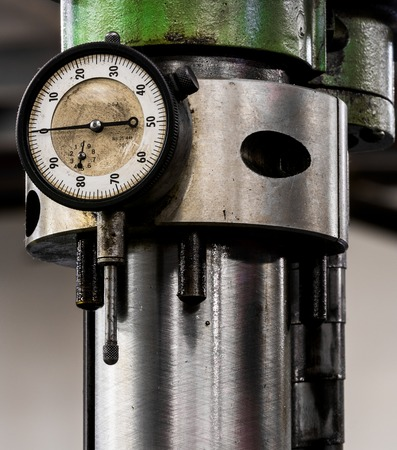 Vintage antique automotive machine shop boaring machine mast with magnetic depth gauge attached on the side Stock Photo