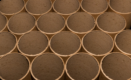 Cardboard tube ends in a bundle with cuts showing in the end 版權商用圖片