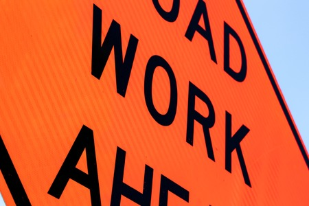 Road work ahead sign close up abstract with a blue sky edge Stock Photo