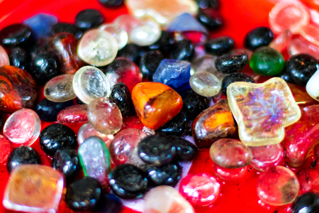 Colorful agate stones with shiny brilliant colors and blur