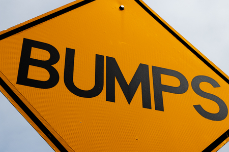 Abstract bumps road sign close up and a blue sky Stock fotó
