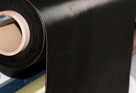 Carbon fiber rolled weave composite material industry Stock Photo
