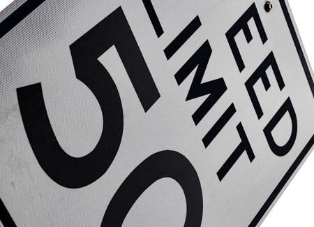 Abstract 50 MPH speed limit sign tilted on angle Stock Photo