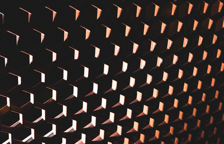 Surreal abstract honeycomb pattern with heavy shadows bright highlights
