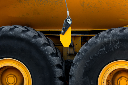 Abstract of heavy duty truck wheels and a yellow body Stock Photo